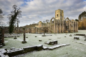 'Cold, bare ruin'd choirs' or simply 'bare ruin'd choirs'? Fountains Abbey, North Yorkshire, in winter. (c) NTPL