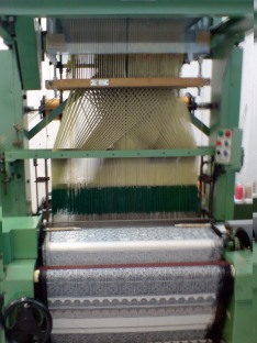 The jaquard loom at work on the hanging